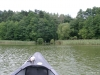 Canoe bow with exit of the lake ahead